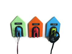 Personalized Leash Holders - Dog Houses with Puppy Tail leash holders for the wall. $14.00, via Etsy.
