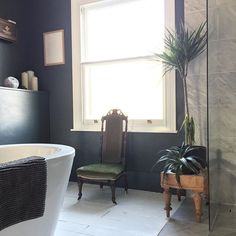 Bathroom at madaboutthehouse.com with downipe walls by farrow and ball, plants and marble tiles