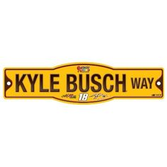 NASCAR Kyle Busch 4.5-by-17 Sign by WinCraft. $9.27. Officially licensed decor signs. Uniquely shaped signs that are produced of durable plastic with die cut hanging hole(s). These signs work well as replacement to a poster because they are nearly indestructible in normal use, and can be washed with soap and water. They work great in outside or indoor applications, and are perfect to hang on doors. Made in USA.