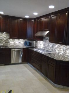 This is almost the flip of our white kitchen - with dark cabinets and light tiles for back splash and flooring.