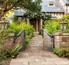 Entry gate with custom light fixtures…English Tudor….featured in Traditional Home Magazine Design by lindafloyd.com