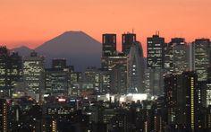 Mount Fuji, Japan's highest mountain at 3,776 meters (12,388 feet), is seen behind skyscrapers in Tokyo's Shinjuku area during sunset