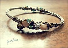 Moonstone adorned recycled bass string bracelet.  Mix and match it with any Jewelree bangle & make a stack of musical adornments on your wrist! <><><><>  https://www.etsy.com/listing/117130735/moonstone-and-glass-recycled-bass-string $28