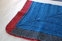Summary A square shawl knit circularly that allows the knitter to insert whatever pattern suits the occasion.
