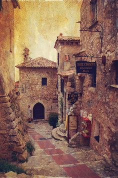 Eze Street in Color. France by Jenny Rainbow.   Available as framed, metal, wood and acrylic prints and canvas.  Online order, delivery,30 days money back guaranty. To shop the print just click on image.  Eze is a medieval village perched like an eagles nest on a narrow rocky peak overlooking the Mediterranean sea.   #JennyRainbowFineArtPhotography   Tags: Home Decor, France, Cote d'Azur, South France, Eze, Buy Art Online, French Town, Romantic Art