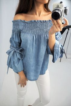 DENIM DREAMING!! Get on trend this spring with this elegant ruched bardot top! Features tie flared sleeves in 2 shades of denim! Dress up or down for day or night! One size Recommended for sizes 8-14 Ruched bardot detail Flared tie sleeves 100% Tensel