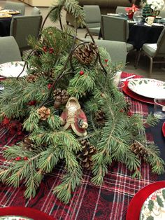 Christmas Table Centerpiece - wine rack, plaid scarf as a runner, pine cones, greenery, berries, Santa - very fragrant!
