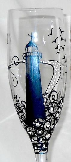 A nautical flair in lighthouse flute glasses hand painted featuring the Bilox Hand Painted Wine Glasses, Painted Wine Bottles, Wine Glass Crafts, Wine Bottle Crafts, Bottle Painting, Bottle Art, Flute Glasses, Eye Glasses, Nautical Art