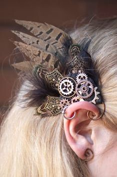 I love how it ties into the ear. SteamPunk Earwings Gears and Angles (pair). Viktorianischer Steampunk, Steampunk Crafts, Steampunk Design, Steampunk Cosplay, Steampunk Wedding, Steampunk Clothing, Steampunk Fashion, Gothic Fashion, Steampunk Female