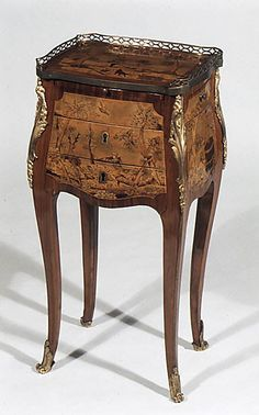5db690ee83343a Small rectangular table Maker: Charles Topino Date: ca. 1775 Culture:  French, Paris Medium: Satinwood, tulipwood and other woods, gilt bronze,  leather