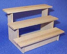 """market stall display - Google Search If shelves were deeper than riser, they could be cut into to slide the """"stair"""" into place where it meets the riser and could be collapsed for easy carrying."""
