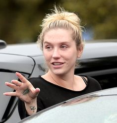 Kesha stepped out in Los Angeles on Feb. 7 without makeup, but with a smile, looking calm and happy one year after rehab