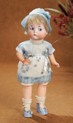 """Large German Bisque """"Just Me"""" by Marseille in Pristine Condition    13"""" (33 cm.) Bisque socket head with plump cheeks paper mache body with modeled bent right elbow,elongated legs.  Realized Price: 2500"""