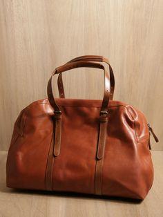 Dries Van Noten brown leather holdall bag.