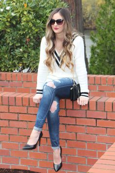 Varsity sweater, ripped off jeans, black pointed toe pumps. Beauty on High Heels #Fashion