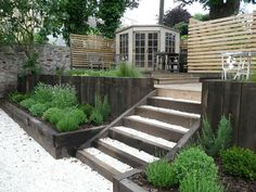 Love the chunky raised beds and the wooden privacy screen