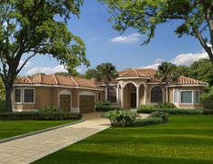 Lovely one level Spanish Mediterranean style home with a large covered patio in the back.  House Plan # 611181.