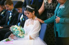 Love this photo of mom behind her daughter at a Quinceanera ceremony