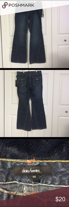 Daisy Fuentes size 12 flare jeans New with tags. Daisy Fuentes flare jeans. Size 12. Indigo wash. Inseams are sewn across flare in untraditional way. Very cool style. Daisy Fuentes Jeans Flare & Wide Leg