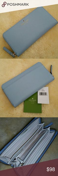 """kate spade lacey mikas pond wallet kate spade lacey mikas pond wallet Wrapped in Sparkly Baby Blue Saffiano Leather with gold tone hardware Zip around wallet accented with gold plated spade emblem + Kate Spade New York embossed on the front and a full length slip pocket on the back Top stitch detailing throughout Approx 8""""L x 4""""W x 1""""D The interior is an ivory leather with coordinating ivory fabric and features a zippered compartment, 12 card slots and multiple full length bill compartments…"""