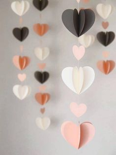 These twirly heart garlands make for a perfectly playful decor piece for your Galentine's Day brunch. Idées déco Saint Valentin DIY - Decoration ideas for Valentines Day Crush On These DIY Hearts (Handmade Charlotte) Ah, February, it's the season of l Saint Valentin Diy, Paper Heart Garland, Paper Garlands, Diy Décoration, Diy 3d, Valentine's Day Diy, Paper Crafting, Paper Flowers, Paper Butterflies