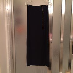 Black spandex material maxi skirt. Has a super cute gold zipper on the front with a slit right under it. Only worn once. Fits more like a S/M. #skirt