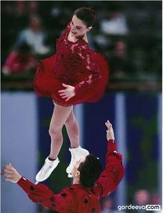 Katia Gordeeva & Sergei Grinkov, 1994 Flamenco SP, Olympics. She smiles even in mid air. :) Love them.