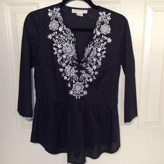NWOT Michael Kors Embroidered Peplum Top Adorable!!  New without tags. Crisp black cotton with sharp embroiderery on bodice. Peplum bottom. SOOO cute!!  3/4 sleeves. Size Small. No trades. Michael Kors Tops Blouses