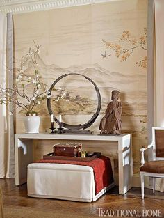 Love the Chinese-influenced credenza, the framed mural, and the elegant pleated drapery panels! Designer Matthew Patrick Smyth