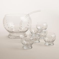 Serve up punch or fruit-laden sangria at your next gathering with this all-glass etched punch bowl set. Featuring a generous bowl, glass ladle and six cups, this set also makes a great wedding gift.