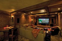 Love the beams, the sectional and lounge chair, curtains, pot lights and game table in the back.