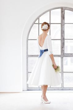 Shelly- tea- length wedding dress with petticoat and blue belt with bow, bateau neckline and very low cut back.