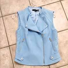 Cool and fashion forward- baby blue moto vest! Darling - zip and snap front- so many ways to wear- amp up your chic in this beauty! Forever 21 Jackets & Coats Vests