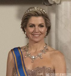 The elaborate necklace is a part of a three-piece parure that also includes the Stuart Tiara and the large diamond bow brooch. The set was created in 1897 for Queen Wilhelmina using a cache of heirloom diamonds that belonged to the royal house. Above, you can see all three pieces, plus several other diamond jewels, on Queen Juliana in 1962. Maxima has now worn two of the three pieces from the House Diamond Parure: the necklace and the bow brooch.