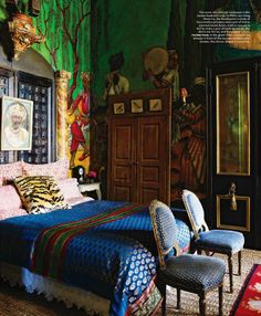 this would probably be a creepy bedroom to sleep in, with all the faces everywhere. but i DO like the richness of the colors. the bedspread is gorgeous.