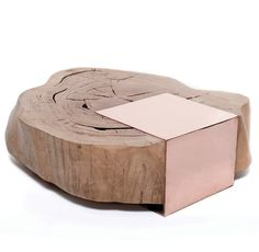 Coffee table by Goet has a rough unfinished piece of wood and keeps the shape of the trunk.  Love the copper support piece that gives it a finished look.