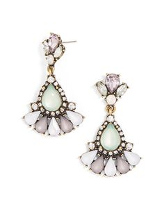 This set of gem-laced confections looks as if it came straight from fairyland with flouncy gem embellishment, frosted green teardrops and opalescent pink stones.