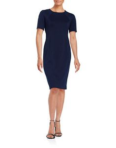 """Sophisticated basic in a classic silhouette. Roundneck. Short sleeves. Back zipper closure. Lined. About 39"""" from shoulder to hem. Polyester/rayon/elastane. Dry clean. Imported."""