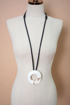 Handcrafted jewelry, made of natural elements. | Style #8019P | Polyester and leather riccione necklace in black and white. Monies Jewelry, Italian Women, Leather Cord, Handcrafted Jewelry, Washer Necklace, Arts And Crafts, Black And White, Pendant, Natural