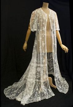 Tamboured lace wedding coat, 1930s. A perfect example of traditional vintage combined with modern dress: the bride wore the graceful wedding coat over a contemporary strapless dress.