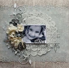 Sweet ~ Monochromatic portrait page with a doily matt and dimensional flowers. I love the contrast between the newsprint background and the lacey borders.
