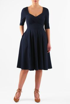 A cross-over empire bodice and full flare skirt accentuate the wide banded waist of our dress in a fit-and-flare silhouette and cut from stretchy jersey knit.