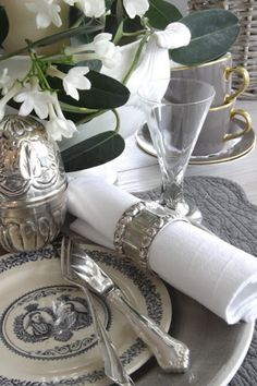 Silver and white ... classic dinner setting ... FROM: http://media-cache-ak0.pinimg.com/originals/7f/30/9a/7f309aba7dd165c27c8c5ee04b5ab856.jpg