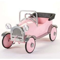 Pink Toy Car - but I'd want a full sized, drive-able one. :)