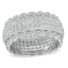 Delightfully feminine this diamond band suits her style perfectly. Fashioned in sleek sterling silver this ring features three rows of shimmering round diamonds that completely encircle the band. Clever diamondlined and ruffled borders anchor the ring at the top and bottom adding flirty style while intricate milgrain detailing completes the look. A romantic look this ring captivates with 113 cts. t.w. of diamonds and a bright polished shine. This ring is available in select size #Fashion…