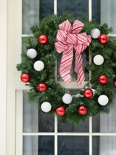 Deck the halls...and windows and doors! With a few simple touches, it's easy to turn a basic wreath into dazzling holiday decor. #lowes #christmas