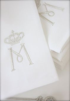 napkins with silvery embroidery