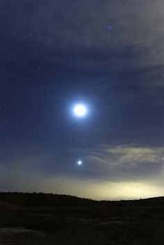 Dots at Sunset By lrargerich  The Moon and Venus setting on the west.