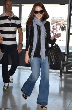 Very Nice! Julianne Moore was clad in a leather jacket and roomy flared jeans as she made ...