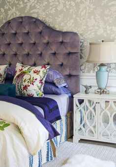 Want this Headboard!!    Elegant purple tufted headboard, mixed fabrics, vintage, floral wallpaper, wainscoting with mirrored nightstand. Love it all!